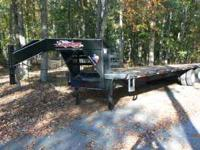 For sale is a 2011 32 ft flatbed gooseneck trailer. The
