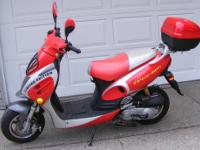 Red & White 2011 Scooter, location: Goshen, IN 46526-