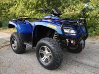 This is a 2011 Arctic Cat 700 LTD H1 Automatic, 4x4,