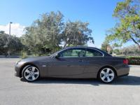 This 2011 BMW 328i has a Gorgeous BLUE finish with TAN
