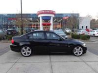 This is a 2011 BMW 335i that is Jet Black on Black