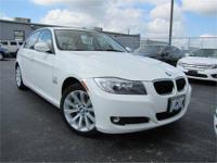 2011 BMW 328i finished in Arctic White. Certified Pre