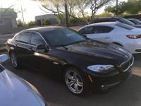 Oyster/Black w/Dakota Leather Upholstery.  2011 BMW 5