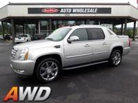 Lofty and sleek, this 2011 Cadillac Escalade EXT turns