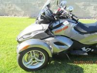 A like new Can Am Beautiful Metal Flake Silver Trike is