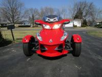 vthis Viper Red Can-am Spyder new and it has been