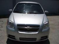 2011 Chevrolet Aveo silver with 72,240 miles. In good