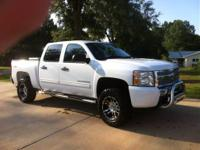 2011 Silverado 1500 4x4. This truck has a 4 inch lift,