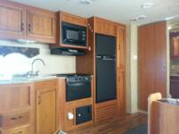 27' with large slide, out door kitchen television,