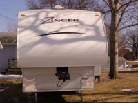 This 27 foot 5th wheel features aluminum siding in