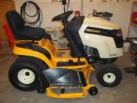 Brand new cub cadet riding lawn mower. The mower has a