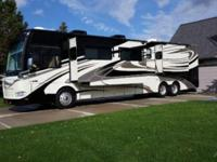 This 2011 Damon Motor Coach is powered by a 360