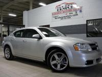 This 2011 Dodge Avenger 4dr Sdn Lux is proudly offered