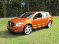 Exterior Color: mango tango pearlcoat, Body: Hatchback,