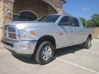 WE HAVE A 2011 DODGE 2500 MEGA CAB BIG HORN EDITION.