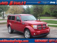 Nitro Heat, 4D Sport Utility, Automatic, and RWD. Red