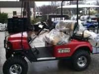2011 E-Z-GO gas new, has factory warranty. Flame red,
