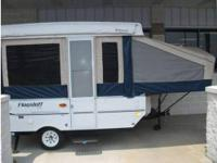 The RV for sale is a new 2011 Flagstaff Pop-up Camper
