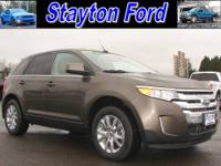 This is a 2011 Ford Edge Limited AWD with 30,293 miles