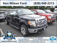 This 2011 Ford F-150 4WD SuperCrew 4x4 Truck features a