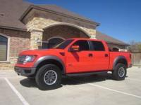 THIS RACE RED 2011 F-150 FORD SVT 4X4 RAPTOR CREW CAB