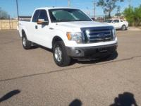From city streets to back roads, this White 2011 Ford