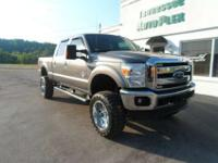 This 2011 Ford F-250 Lariat Super Duty is lifted up to