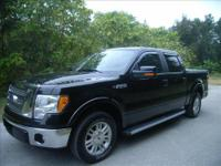 HERE IS A BEAUTIFUL LOW MILE 2011 LARIAT F-150 EQUIPPED