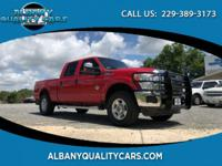 Red 2011 Ford F-250SD XLT 4WD TorqShift 6-Speed