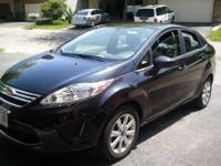 2011 Black on Black Ford Fiesta. Just rolled 25,000