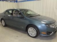 This 2011 Ford Fusion Hybrid comes geared up with a