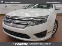 ======: This 2011 Ford Fusion SEL Sedan has a White