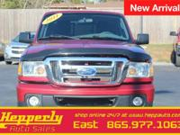 This 2011 Ford Ranger XLT in Redfire Metallic features.
