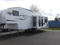 2011 Forest River Rockwood 8288SS. Pre-Owned Certified