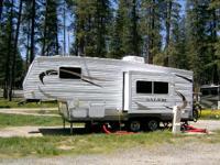 2011 Forest River Salem M-F23RKS and a 1997 Dodge Truck