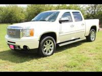 This WHITE 2011 GMC Sierra 1500 Denali might be just