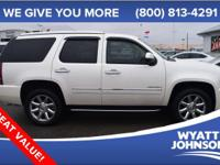 Stop clicking the mouse because this 2011 GMC Yukon is