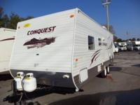 This is a 2011 Gulfstream Conquest 24BHL Camper that is