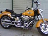Excellent condition ready to ride! 2011 yellow Fat Boy,