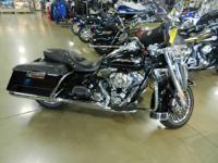 The 2011 Harley-Davidson Touring Road King FLHR is
