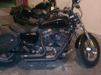 2011 Harley Davidson XL 1200 C. 17400 miles. Excellent