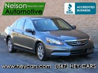 This One Owner Accord SE is a beautiful dark grey with