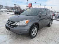 This 2011 Honda CR-V is a crossover SUV that straddles
