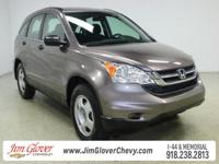 Drive home this 2011 Honda CR-V LX in Urban Titanium