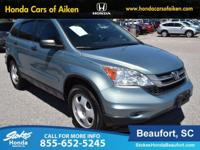 2011 Honda CR-V in Green. Ample interior storage space.