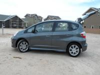 This smoke-free and garaged 2011 Honda Fit Sport has