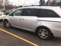 This outstanding example of a 2011 Honda Odyssey EX-L