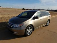 We are excited to offer this 2011 Honda Odyssey. This