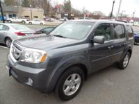 This outstanding example of a 2011 Honda Pilot EX is