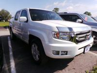 Check out this 2011 Honda Ridgeline RTL. Its Automatic